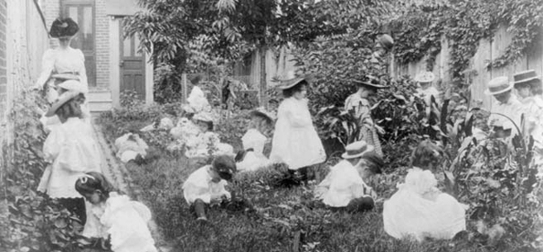 kindergarten: children in a garden with a teacher